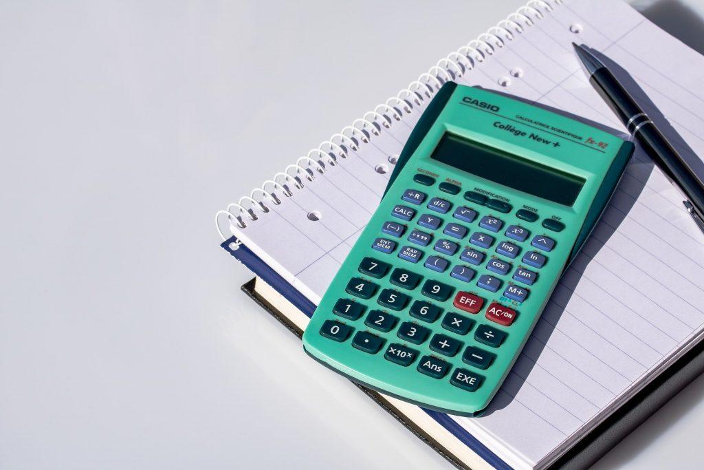 calculator on desk to represent grant writer compensation