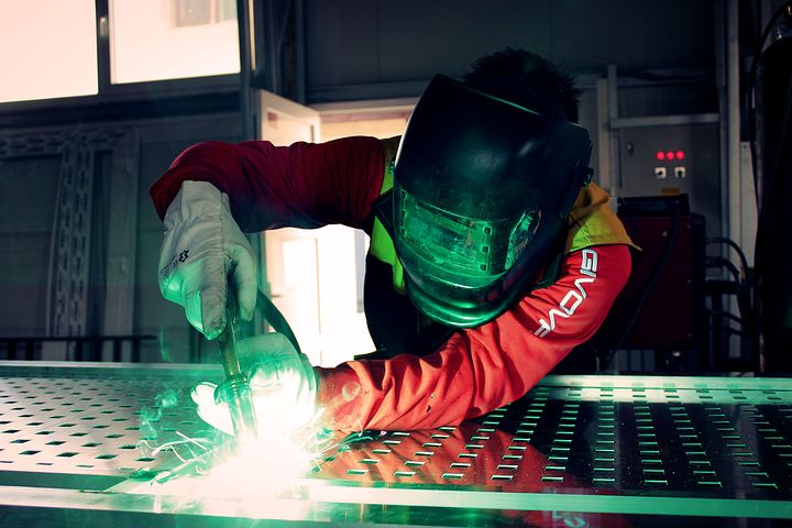 Welder in a manufacturing facility
