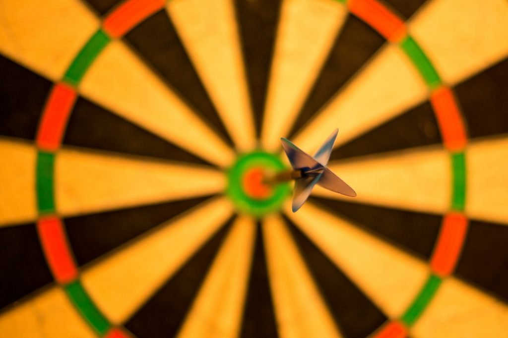 Grant writing success rate depicted by a dart in a bullseye